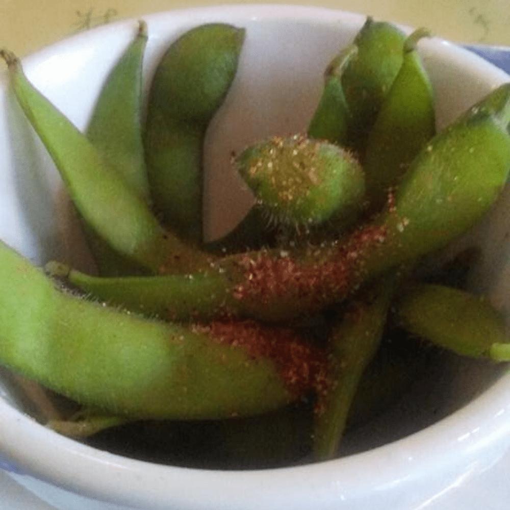brown sugar spiced edamame in a white dish