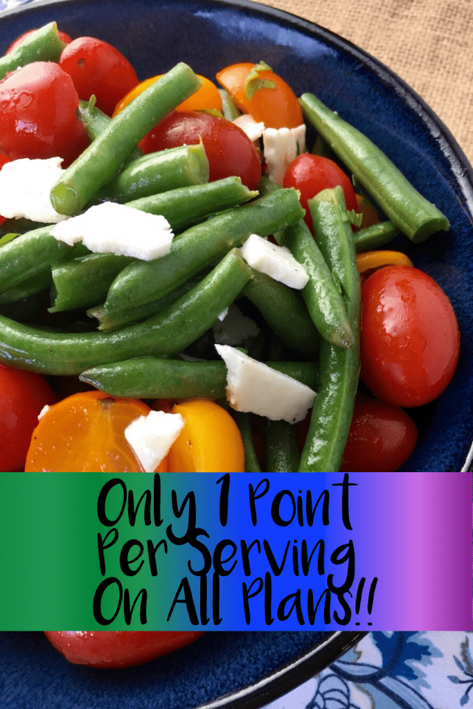 Greek Green Bean Salad with Tomatoes and Feta in a blue bowl